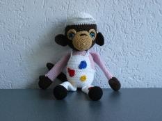 Leuke aap met verfvlekken